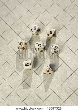 Polyhedral dice on blank game grid used in roleplaying game