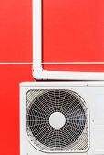 close up air conditioner machines on red wall poster
