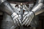 Detail of a knight armor with sword poster