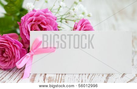 Card With Roses On The Table