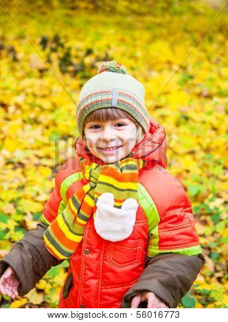 Happy Child Playing In Autumn Park