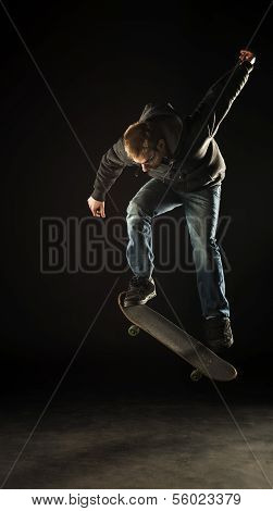 Skateboarder At Night