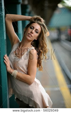 Woman posing pretty in NYC subway station outside