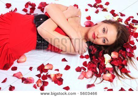 Woman In Rose Petals