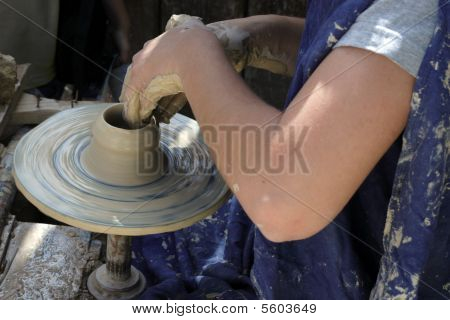 Craftwoman's Hands Making Pottery On A Ceramic Wheel