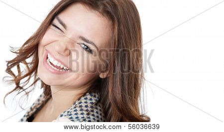 Young Female Winking And Laughing