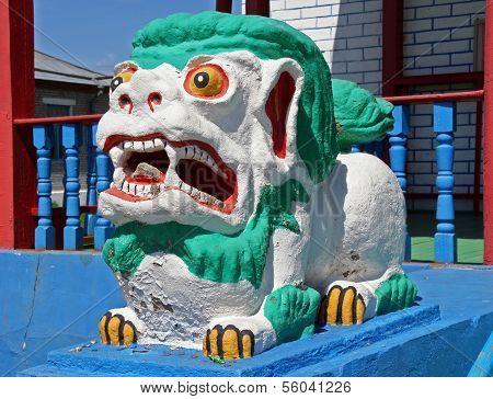 Colorful Statue Of Shishi Lion Guards Entrance To Lamaist Temple Near Ulan Ude, The Capital Of Burya