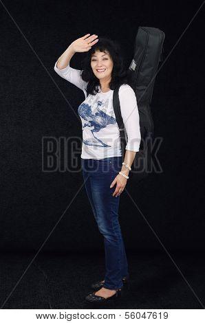 Woman Guitarist On The Dark Grey Background