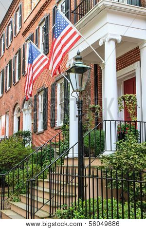 Colonial Brick Architecture With American Flags
