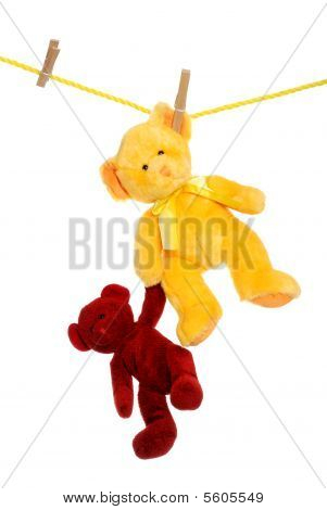 Teddy Bear On Clothes Line Rescuing Another