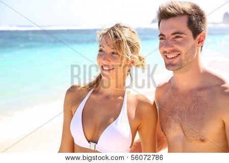 Young couple enjoying paradisiacal beach