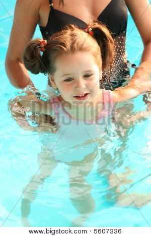 Mom and daughter in the swimming pool