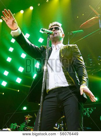 BOSTON-DEC 14: Singer Robin Thicke performs at KISS 108's Jingle Ball 2013 at TD Garden on December 14, 2013 in Boston.