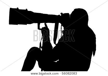 Silhouette Of Photographer Sitting With Large Lens