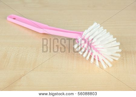 Toilet brush on wooden background