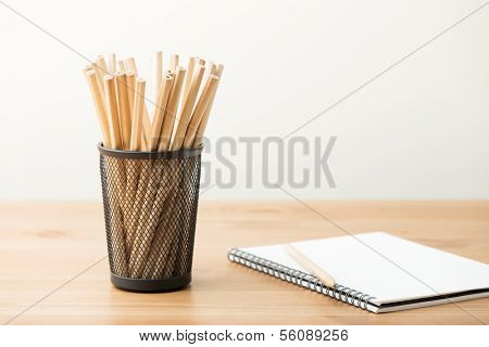 Pencil pot and notebook