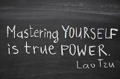 """excerpt from famous Lao Tzu quote """"Mastering others is strength. Mastering yourself is true power."""" handwritten on blackboard poster"""