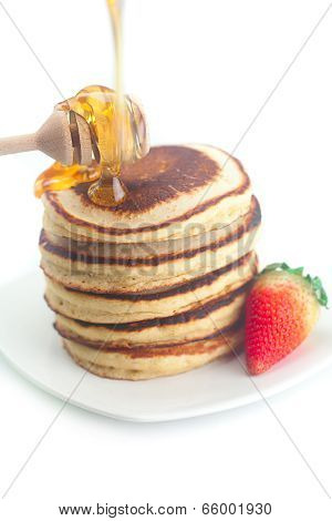 Pancakes, Honey, Strawberry And Stick To Honey Isolated On White
