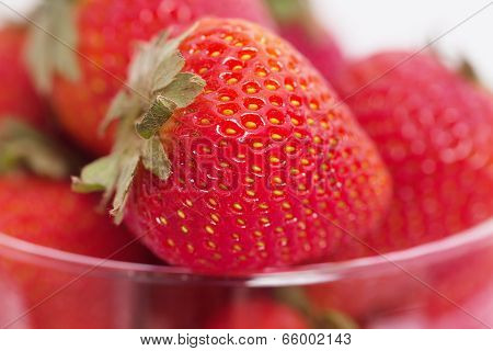 Strawberry In A Glass Bowl Isolated On White