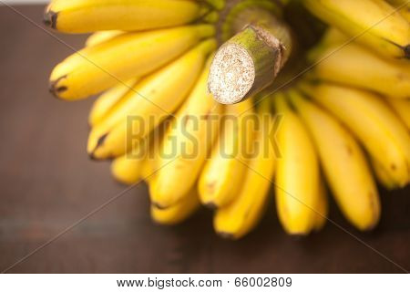 Bunch Of Bananas On A Wooden Surface