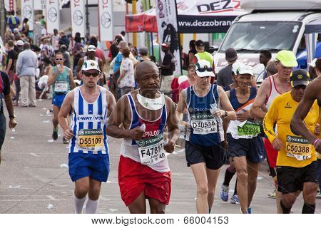 Determined Competitors Competing In Comrades Ultra Marathon
