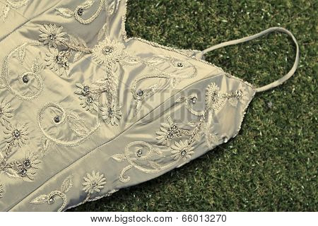 Vintage Wedding Dress Lying On Grass