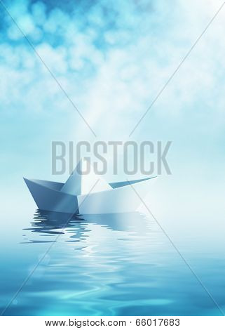 Paper origami boat on azure water surface