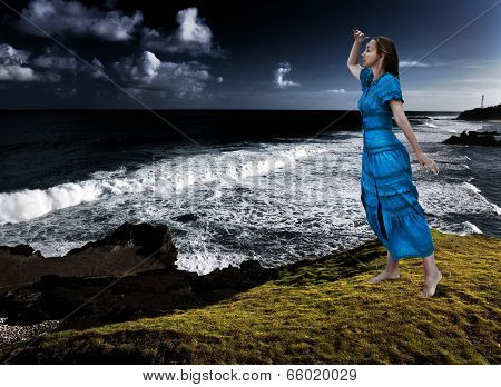 The woman on the edge of a breakaway over the storming sea