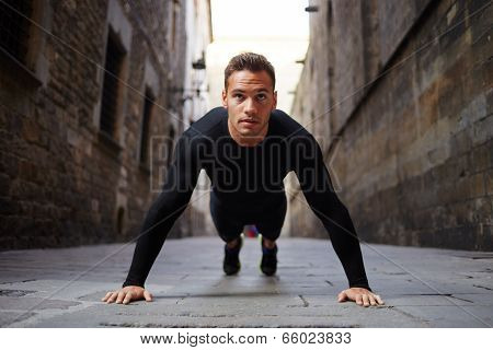 Strong attractive runner is pushed from the floor before jog