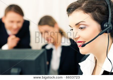 Business team with computer and headphone