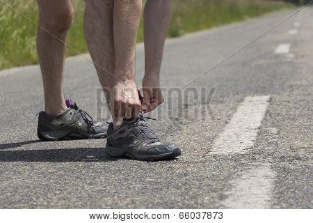 Jogger Man Binding The Shoe Strings