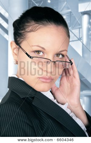 Beautiful Brown-haired Woman In The Hall With Ladder