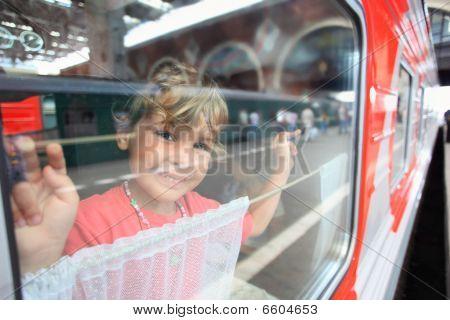Smiling Little Girl Look From Train Window