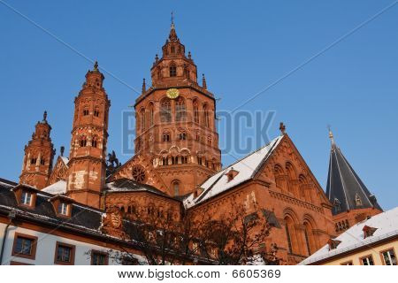 Mainz Cathedral (Mainzer Dom) in the Old Town of Mainz Germany on a Beautiful Winter's Day. Clear Blue Sky Snow Dusted Roof. poster
