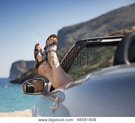 female legs dangling from the open car window in the shales Stock Photo: Image ID: 146438690