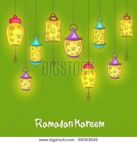 Illuminated hanging lanterns on green background for holy month of Muslim community Ramadan Kareem on green background.