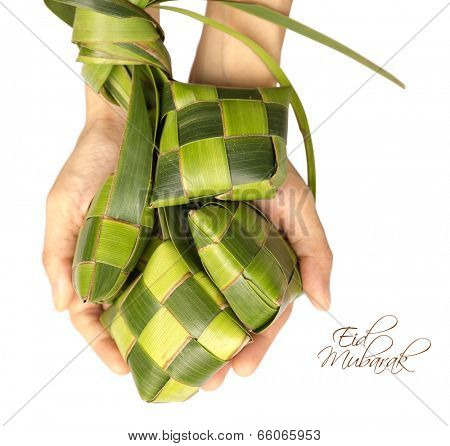 Hand Held Muslim Ketupat (Rice Dumpling) with Clipping Path. Translation: Eid Mubarak - Blessed Feast