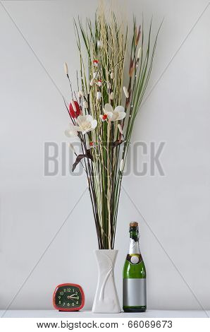 Fake Flowers With Wine Bottle And Alarm Clock