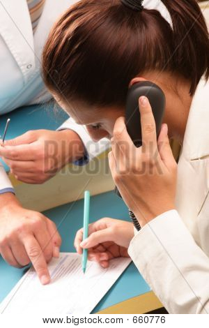 Medical secretary making an appointment by phone