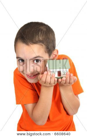 Boy Holdind A Toy House