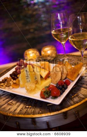 Cheese, fruit, cookies and honeycomb