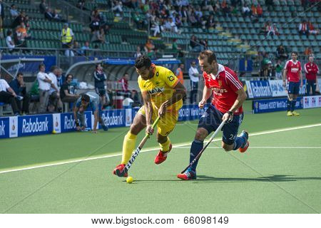 THE HAGUE, NETHERLANDS - JUNE 2: Englishman Catlin reaches for the ball to stop a rush by Indian player Raveendran  during the Hockey World Cup 2014. GBR beats IND 2-1