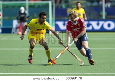 THE HAGUE, NETHERLANDS - JUNE 2: English field hockey player Ashley Jackson crosses sticks with an unidentified Indian player at the Rabobank World Cup Hockey. ENG beats IND 2-1