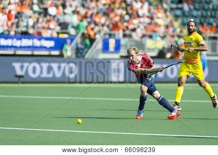 THE HAGUE, NETHERLANDS - JUNE 2: English Player Barry Middleton passes the ball forward during the match between England and India (2-1) at the World Cup Hockey