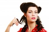 Retro style. Coquette woman playing with hair isolated on white. Flirty brunette girl with pinup hairstyle and makeup. poster