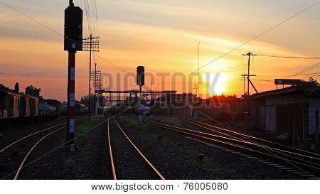Railway Tracks At Train Station At Twilight Sky