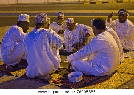 Arabi Men Play Cards at night