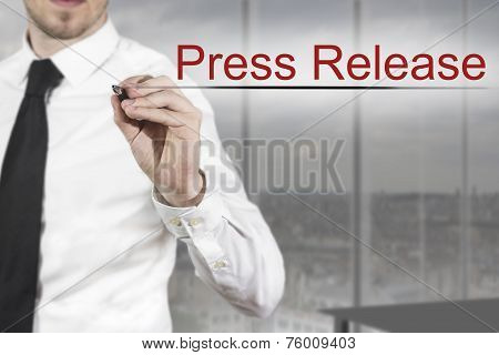 Businessman Writing Press Release In The Air