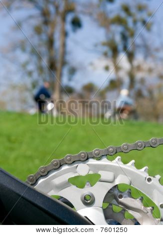 Bicycle Chain Over Blurred Cyclist