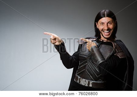 Funny knight against dark background